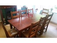 8 solid oak chairs and matching pine table 6ft x 3ft. Inside dinning set.