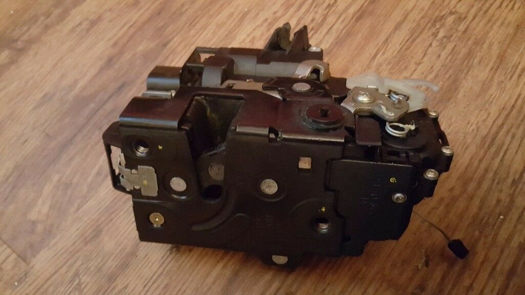 Seat rear driver side central locking door lock Genuine part.