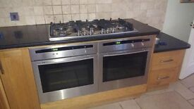 Twin Neff ovens, with 6 ring gas hob and hood