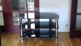 Black Glass and Chrome Widescreen TV stand.