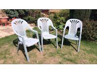 Three plastic garden chairs