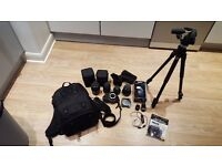 Complete Nikon D5100 kit with 4 lenses + Manfroto tripod & head + accesories