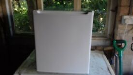 mini fridge. Ideal well space is a premium.small ice compartment.Little used.