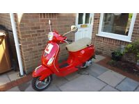 Red Piaggio Vespa LX 124cc + free waterproof fleece lined apron