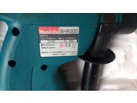 Makita BHR200 cordless sds drill and new battery.