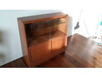 Small wooden bookcase or display cupboard with glass doors - good upcycling project