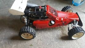 1/5 scale petrol buggy ,fully working with remote and set spare of wheels