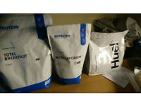 Assortment of HUEL and MyProtein's supplements
