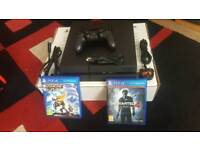 ps4 with 2 games boxed and tv