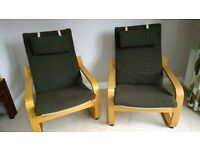 Two IKEA Poang chairs with 2 spare cushion pads