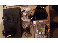 Three PlayStation 2s