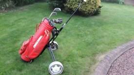Full set of golf irons, bag and trolley