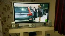 Panasonic tv with surround sound system plus sub woofer.