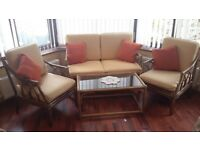 Cane Sofa and two chairs with glass top coffee table