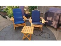 Rocking chair, Lounge chair with attached footstool, both with cushions, and a small side table