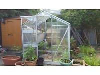 Small greenhouse with extra glass