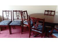 Solid mahogany dining table with extension and brass claw feet also 4 dining chairs and 2 carvers