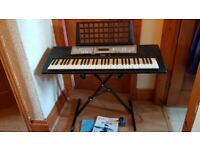 Yamaha PSR-E203 Keyboard plus stand and books never used excellent condition