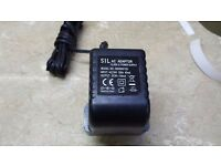 SIL AC ADAPTOR CLASS 11 POWER SUPPLY MODEL NO# BD090015D 9VDC 150mA