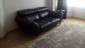Black leather 2 seater sofa 190 cms long Headrests move to suit CAN DELIVER