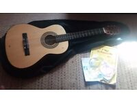 Guitar plus book case and strings
