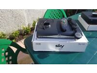 2 sky boxes one Digital and one HD with accesories as shown