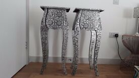 Pair of embossed black/silver bedside tables in excellent condition