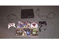 PS3 + 4 games and controllers