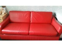 Lovely red sofa bed ecvellant condition only used a few times