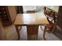 Children's Solid wooden table & 2 chairs.
