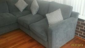 Corner settee brand new in gray with cushion
