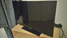 JVC 32 inch with DVD black on stand