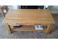 Two drawer solid light Oak Coffee table with two drawers.