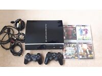PS3, 4 Games, 2 Controllers and HDMI cable.