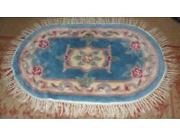 OVAL CHINESE RUG 44INCHES X 25 INCHES