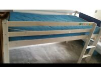 Single wooden bed with mattress