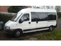 Fiat Ducato Minibus Conversation, Two Berth with 4 Traveling Seats with Vango Air Drive A Way Awning