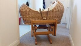 Beautiful moses basket and gliding stand.