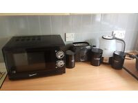 Kitchen items - microwave, toaster, kettle & cannisters