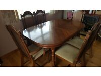 DINING ROOM TABLE, 4 CHAIRS AND 2 CARVER CHAIRS. USED BUT IN GOOD CONDITION. £100 ONO