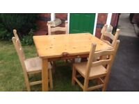 Large Pine wooden table with 4 matching wooden chair