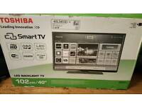 Toshiba 40 inch led smart tv and stand