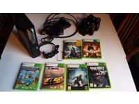 Xbox 360 + 6 Games, 2 Controllers, Controller charging dock, HDMI Cable, Xbox 360 headset