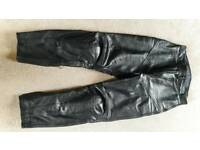Motor bike leather trousers.