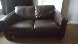 Dark brown leather sofa for sale.