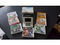 Nintendo 3ds + 7 games + holder