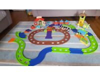 Happyland country train set, airport and garage with lots of extra bits in great condition