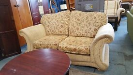 Beige floral fabric winged two seater sofa