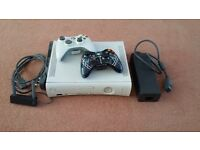 Xbox 360, 2 Controllers, 2 Memory Cards, 120GB HDD, Wireless Networking Adaptor and all Cables.