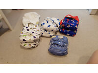 8 reusable cloth nappies, inserts and liners